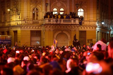 Bosnia's players were perched on balcony in Sarajevo on Oct. 16 as fans celebrated qualification for the 2014 World Cup.